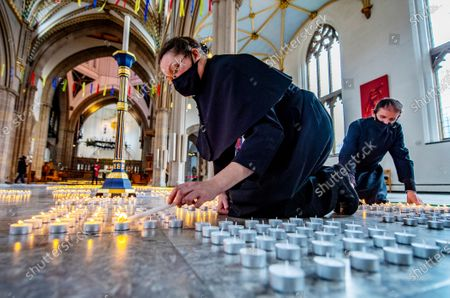 1st Anniversary of the National Lockdown in a Day of national reflection at Blackburn Cathedral, Lancs. Verger Rachel Fielding and Mark Pickering (pictured) . - More than 4000 candles are lit ,one for every Lancs life lost