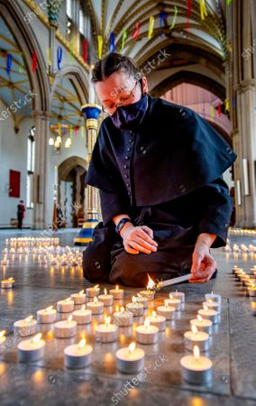1st Anniversary of the National Lockdown in a Day of national reflection at Blackburn Cathedral, Lancs. Verger Rachel Fielding (pictured) . - More than 4000 candles are lit ,one for every Lancs life lost
