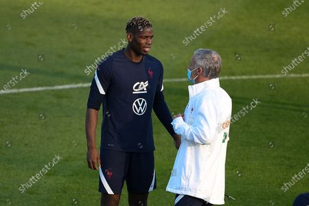 Didier Deschamps and Paul Pogba during a training session before the world cup qualification match between France and Ukraine in Clairefontaine center