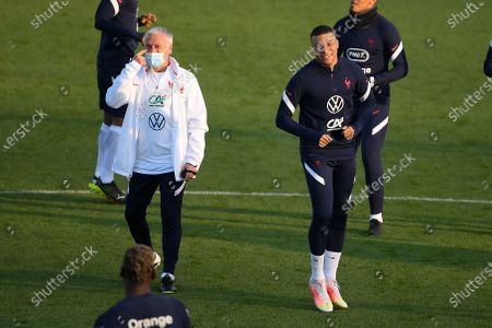 Kylian MBappe and Didier Deschamps during a training session before the world cup qualification match between France and Ukraine in Clairefontaine center