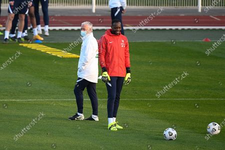 Didier Deschamps and Steve Mandanda during a training session before the world cup qualification match between France and Ukraine in Clairefontaine center