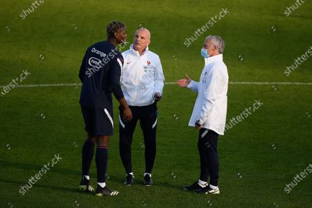 Didier Deschamps, Guy Stephan and Paul Pogba during a training session before the world cup qualification match between France and Ukraine in Clairefontaine center