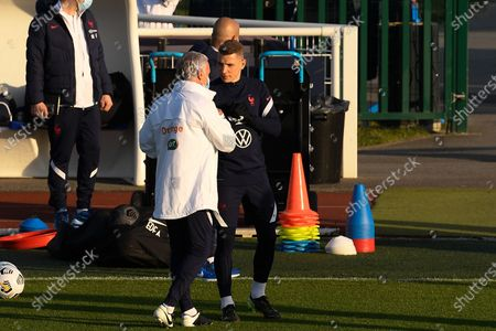 Didier Deschamps and Lucas Digne arrive for a training session before the world cup qualification match between France and Ukraine in Clairefontaine center