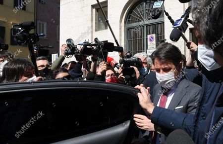 Former Prime Minister and senior member Five Star Movement Giuseppe Conte (R) leaves after the meeting with the secretary of the Democratic Party Enrico Letta in Rome, Italy, 24 March 2021.
