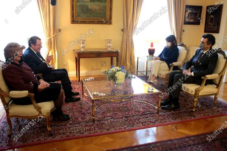 Greek President Katerina Sakellaropoulou (2-R), her partner Pavlos Kotsonis (R), the President of Cyprus, Nicos Anastasiades (2-L), and his wife, Andri (L) during their meeting at the Presidential Mansion, in Athens, Greece 24 March 2021.The anniversary events for the 200 years since the Revolution of 1821 are held with all formalities and the strict observation of all health protection measures against the coronavirus. Among the senior guests who will attend the events is the Russian Prime Minister, Mikhail Mishustin, the Prince of Wales, Charles, together with the Duchess of Cornwall Camilla, the Minister of Defense of the French Republic, Florence Parly, as well as the President of Cyprus, Nicos Anastasiades, together with his wife, Andri.