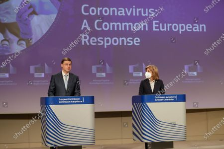 European Commission Vice-President Valdis Dombrovskis (L) and European Commissioner for Health and Food Safety Stella Kyriakides (R) give a press conference on the Export transparency and authorisation mechanism at the European Commission in Brussels, Belgium, 24 March 2021.