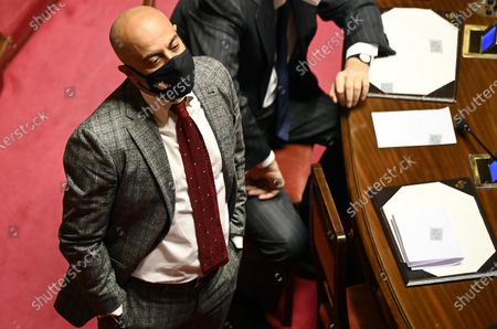 Stock Image of Senator of Italexit Gianluigi Paragone looks on during Italian Prime Minister Mario Draghi's speech at the Senate ahead of the upcoming European Council meeting, in Rome, Italy, 24 March 2021.