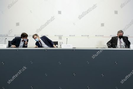 From left, Walloon Minister President Elio Di Rupo, Belgium's Prime Minister Alexander De Croo and Flemish Minister President Jan Jambon prepare to address a media conference after a meeting of the consultative committee of government ministers in Brussels, . Ministers met on Wednesday to discuss a possible tightening of COVID-19 measures as infections are once again on the rise
