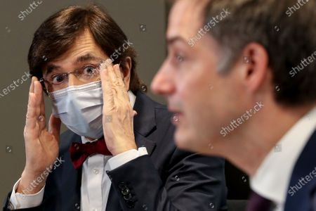 Belgium's Prime Minister Alexander De Croo and Minister-President of Wallonia Elio Di Rupo (L) during a media conference after a meeting of the consultative committee of government ministers in Brussels, Belgium, 24 March 2021. Ministers met on 24 March to discuss a possible tightening of COVID-19 measures as infections are once again on the rise.