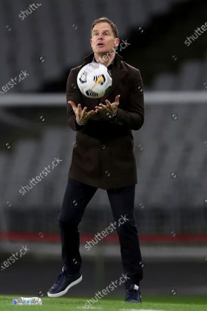 Netherlands' head coach Frank de Boer catches the ball during the World Cup 2022 group G qualifying soccer match between Turkey and Netherlands at the Ataturk Olimpiyat Stadium in Istanbul, Turkey