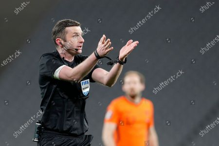 Referee Michael Oliver gestures during the World Cup 2022 group G qualifying soccer match between Turkey and Netherlands at the Ataturk Olimpiyat Stadium in Istanbul, Turkey