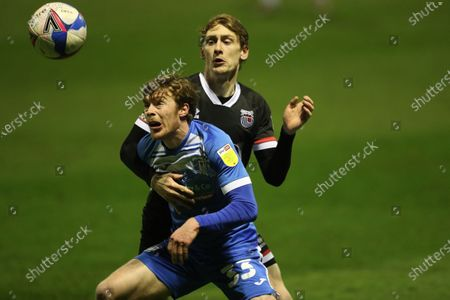 Luke James of Barrow and Elliott Hewitt of Grimsby Town  during the Sky Bet League 2 match between Barrow and Grimsby Town at the Holker Street, Barrow-in-Furness on Tuesday 23rd March 2021.