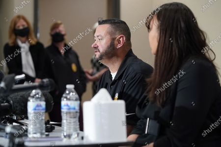 Stock Picture of Robert Olds, back, uncle of Rikki Olds, the store manager who was one of 10 victims in the mass shooting at a King Sooopers grocery store in Boulder, Colo., talks about his niece during a news conference, in Lafayette, Colo. One of Rikki Lake's co-workers at the store, Carlee Lough, looks on