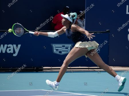 Stock Photo of Venus Williams from the USA returns the ball to Zarina Diyas from Kazakhstan on the stadium court at the Miami Open in the Hard Rock Stadium in Miami Gardens, Florida onTuesday, March 23, 2021.  Diyas defeated Williams in a tie breaker 6-2, 7-6 (12-10).