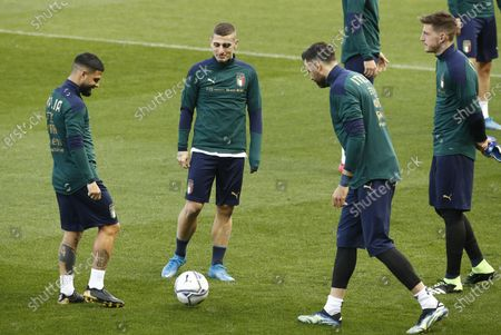 Italy's national soccer players (L-R) Lorenzo Insigne, Marco Veratti and Salvatore Sirigu attend a training session at Ennio Tardini stadium in Parma, Italy, 24 March 2021, on the eve of their FIFA World Cup Qatar 2022 qualification match against Northern Ireland.
