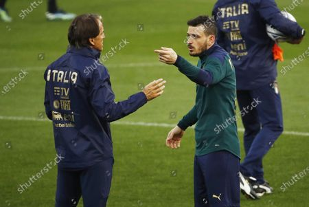 Italy's national soccer team head coach Roberto Mancini (L) talks to his player Alessandro Florenzi during a training session at Ennio Tardini stadium in Parma, Italy, 24 March 2021, on the eve of their FIFA World Cup Qatar 2022 qualification match against Northern Ireland.