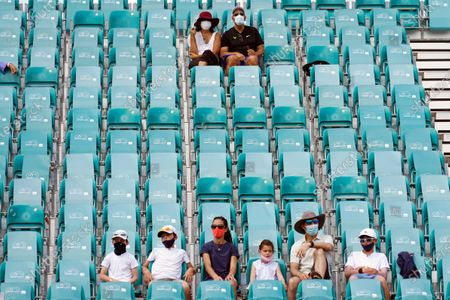 Spectators watch a match between Danielle Collins and Kristina Mladenovic on the Grandstand court during the Miami Open tennis tournament, in Miami Gardens, Fla