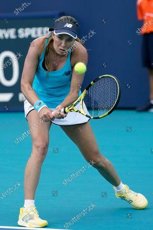 Danielle Collins returns to Kristina Mladenovic, of France, during the Miami Open tennis tournament, in Miami Gardens, Fla