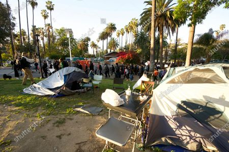 Homeless activists supporting the Echo Park Lake homeless encampment march to the nearby offices of Los Angeles Councilmember Mitch O'Farrell in Los Angeles, . Demonstrators gathered Wednesday to protest the planned closure of a Los Angeles park that would displace a large homeless encampment that has grown throughout the coronavirus pandemic