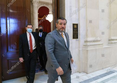 Sen. Ted Cruz, R-Texas, joined by Sen. John Barrasso, R-Wyo., left, chairman of the Senate Republican Conference, and others leave a luncheon on Capitol Hill in Washington