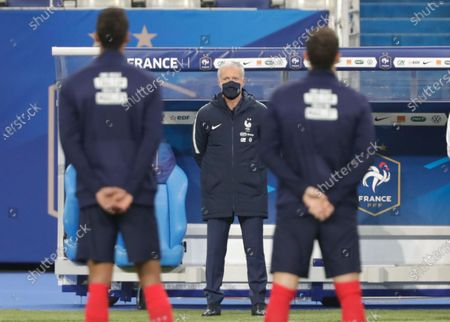France head coach Didier Deschamps, center, looks on before the World Cup 2022 group D qualifying soccer match between France and Ukraine at the Start de de France stadium, in Saint Denis, north of Paris