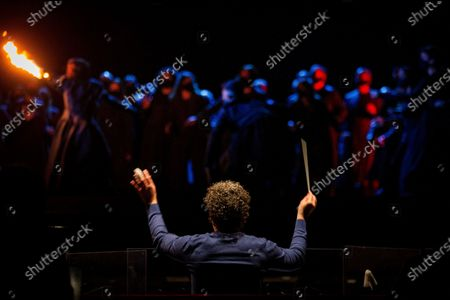 Venezuelan conductor Gustavo Dudamel (C) conducts the Grand Liceu Theater Symphonic Orchestra during a press preview for the opera 'Otello' at the Liceu Theater in Barcelona, Spain, 24 March 2021. The opera production will run at the Liceu from 27 March to 14 April.