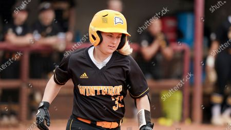 Stock Photo of Winthrop's Taylor Charlton runs to first during an NCAA college softball game against Gardner-Webb, in Rock Hill, S.C. Winthrop won 9-0