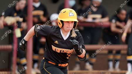 Winthrop's Taylor Charlton runs to first during an NCAA college softball game against Gardner-Webb, in Rock Hill, S.C. Winthrop won 9-0