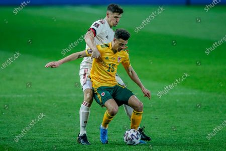 Wales' Ethan Ampadu, right, vies for the ball with Belgium's Thomas Meunier during a World Cup 2022 group E qualifying soccer match between Belgium and Wales at the King Power stadium in Leuven, Belgium