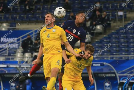 Stock Picture of Anthony Martial (C) of France, Serhiy Kryvtsov (L) of Ukraine and Illia Zabarni (R) of Ukraine in action during the 2022 FIFA World Cup qualification UEFA Group D soccer match France vs Ukraine in Saint Denis, outside Paris, France, 24 March 2021.