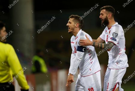 Stevan Jovetic (L) of Montenegro with his teammate Aleksandar Scekic celebrates after scoring the goal during the FIFA World Cup 2022 Group G qualification soccer match between Latvia and Montenegro in Riga, Latvia, 24 March 2021.
