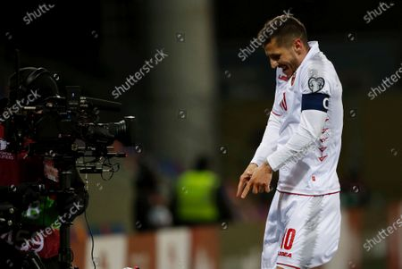 Stevan Jovetic of Montenegro celebrates after scoring during the FIFA World Cup 2022 Group G qualification soccer match between Latvia and Montenegro in Riga, Latvia, 24 March 2021.