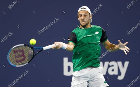 Stefano Travaglia of Italy in action against Frances Tiafoe of the USA during their Men's singles match at the Miami Open tennis tournament in Miami Gardens, Florida, USA, 24 March 2021.