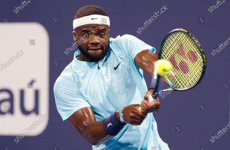 Frances Tiafoe of the USA in action against Stefano Travaglia of Italy during their Men's singles match at the Miami Open tennis tournament in Miami Gardens, Florida, USA, 24 March 2021.