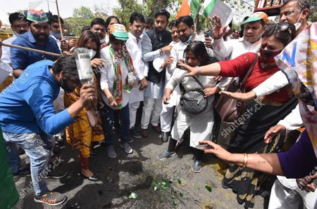 Delhi Congress workers, broken liquor bottle demonstration to protest against the new excise policy and including lowering of drinking age from 25 to 21 years, Congress against the promotion of liquor sales to help the liquor mafia in profiteering by the Delhi Government, Near the residence of the Chief Minister Arvind Kejriwal at Civil Lines on March 24, 2021 in New Delhi, India.