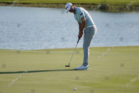 Matt Jones of Australia putts on the 16th hole during the final round of the Honda Classic golf tournament, in Palm Beach Gardens, Fla