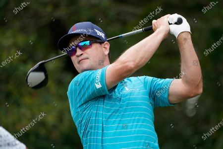 Zach Johnson hits from the third tee during the third round of the Honda Classic golf tournament, in Palm Beach Gardens, Fla