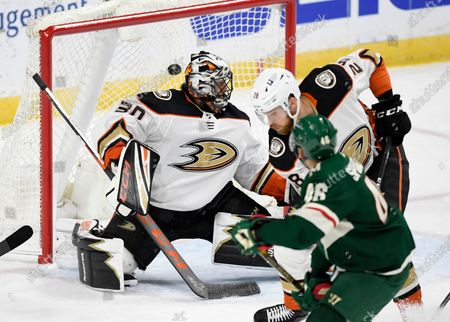 Minnesota Wild's Jared Spurgeon (46) watches as the his goal gets by Anaheim Ducks goaltender Ryan Miller (30) and Jani Hakanpaa (28), of Finland, during the first period of an NHL hockey game, in St. Paul, Minn