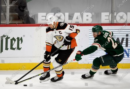 Anaheim Ducks' Ryan Getzlaf (15) is defended by Minnesota Wild's Nick Bjugstad (27) during the third period of an NHL hockey game, in St. Paul, Minn