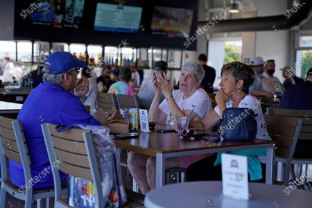STORY-Baseball fans gather in the Bullpen Club at George M. Steinbrenner Field before a spring training exhibition baseball game between the New York Yankees and the Toronto Blue Jays in Tampa, Fla