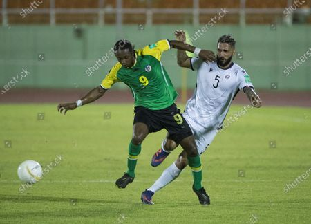 Andrea Bosco (R) of the Dominican Republic vies for the ball with Javid George of Dominica during a Qatar 2022 World Cup Qualifying round soccer match at Felix Sanchez stadium in Santo Domingo, Dominican Republic, 24 March 2021.