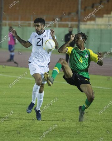Francisco Nunez (L) of the Dominican Republic vies for the ball with Malcom Joseph of Dominica during a Qatar 2022 World Cup Qualifying round soccer match at Felix Sanchez stadium in Santo Domingo, Dominican Republic, 24 March 2021.