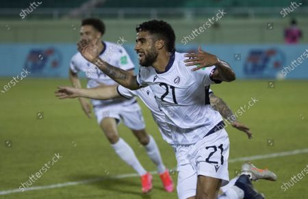 Francisco Nunez (R) of the Dominican Republic celebrates after scoring against Dominica during a Qatar 2022 World Cup Qualifying round soccer match at Felix Sanchez stadium in Santo Domingo, Dominican Republic, 24 March 2021.