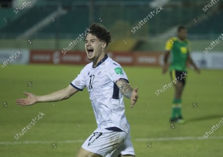 Rudolf Gonzalez of Dominican Republic celebrates after scoring against Dominica during a Qatar 2022 World Cup Qualifying round soccer match at Felix Sanchez stadium in Santo Domingo, Dominican Republic, 24 March 2021.
