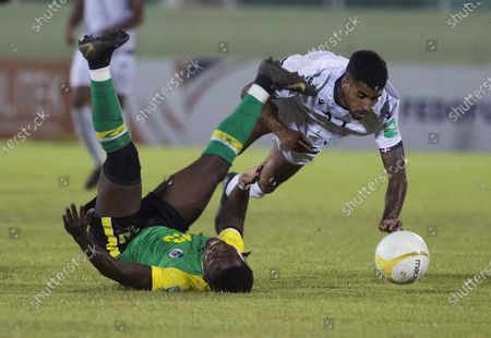 Benjamin Nunez (C) of Dominican Republic in action against Darryl Longdon of Dominica during a Qatar 2022 World Cup Qualifying round soccer match at Felix Sanchez stadium in Santo Domingo, Dominican Republic, 24 March 2021.