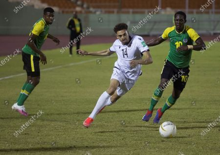 Luis Angel Nunez (C) of Dominican Republic in action against Kelrick Walter of Dominica during a Qatar 2022 World Cup Qualifying round soccer match at Felix Sanchez stadium in Santo Domingo, Dominican Republic, 24 March 2021.