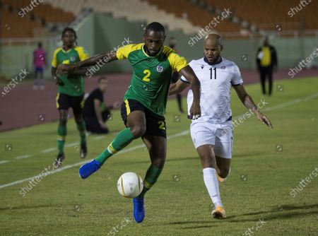 Domingo Peralta (R) of Dominican Republic in action against Erskin Williams of Dominica during a Qatar 2022 World Cup Qualifying round soccer match at Felix Sanchez stadium in Santo Domingo, Dominican Republic, 24 March 2021.