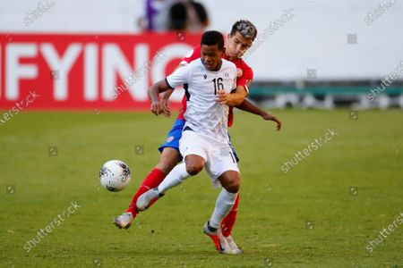 Stock Picture of Yurguin Roman (R) of Costa Rica in action against Lean Torres of Dominican Republic during the CONCACAF Men's Olympic Qualification tournament between at Jalisco Stadium, in Guadalajara, Mexico, 24 March 2021.