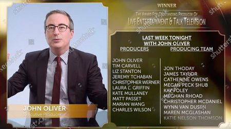 """John Oliver accepts the award for Live Entertainment & Talk Television for """"Last Week Tonight with John Oliver (Season 7)"""" at the 32nd Annual PGA Awards presented by General Motors on"""