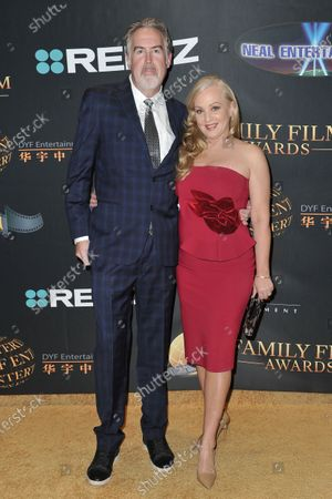 Stock Picture of Greg Covey, left, and Wendi McLendon-Covey arrives at the 24th Family Film Awards at Universal Hilton Hotel, in Los Angeles
